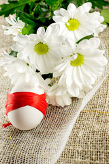 Easter card with eggs and daisies