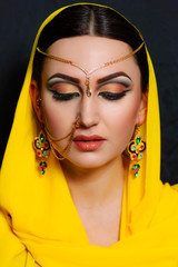 A girl with bright makeup in Indian saris