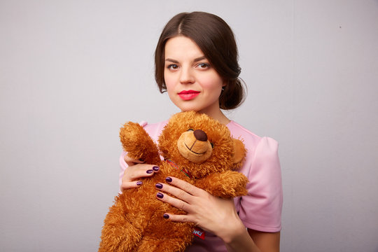 young woman with a teddy bear