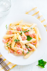 Penne pasta with shrimps, cream sauce