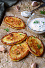Mashed Potato Fritters with Sour Cream on wooden rustic background