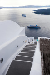 Santorini island with ships in Greece
