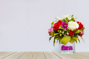 Beautiful Multi Color of Roses in Glass Flowerpot at The Corner on Wooden Table with Gray Background with Copyspace for Mock up to Display Product or input Text on Valentine Event