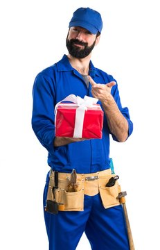 Plumber holding a gift