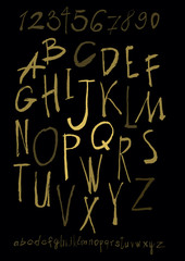 Alphabet letters lowercase, uppercase and numbers gold on black.