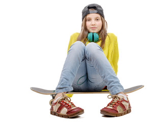 pretty young girl posing with a skateboard, sitting on skate, o