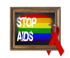 LGBT flag STOP AIDS World Aids Day concept with red ribbon and aids awareness