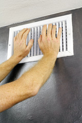 Hands on an Air Vent