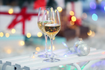 Two glasses of wine on Christmas decoration background