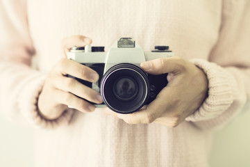 Girl with vintage camera in the hands
