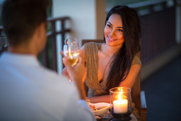 young couple with a romantic dinner with candles