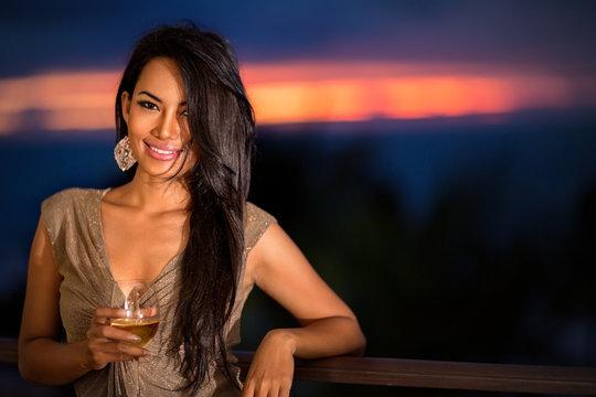 Beautiful woman over sunset background