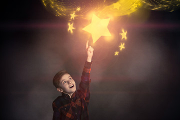 Cute Boy Touching a Glowing Yellow Star Over Him