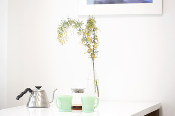 Cup of coffee and flower on table in Dinning room