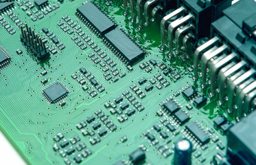 Closeup of Printed Circuit Board with Mounted Components.