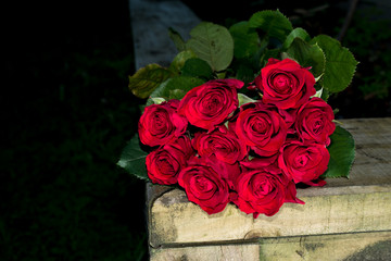 Valentine's roses bouquet  on a rustic wood