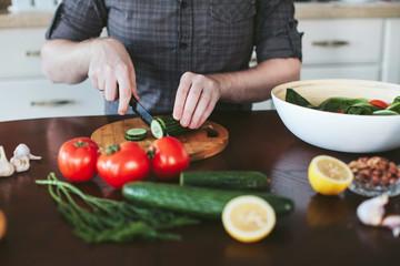 hands man preparing vegetarian salad in the kitchen