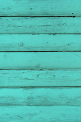 Natural wooden turquoise boards, wall or fence with knots. Mint painted wooden horizontal planks. Green abstract textured background, empty template
