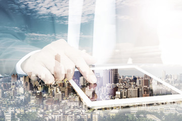 Double exposure of a businessman with his arms folded with city background