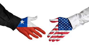 Chile and United States leaders shaking hands on a deal agreement