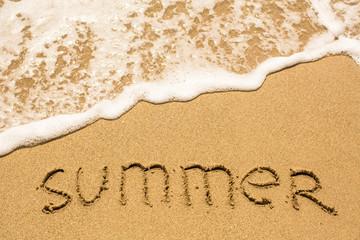 SUMMER inscription on the sea beach sand, soft wave.