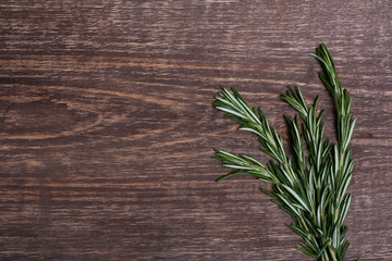 Rosemary on a wooden background close-up
