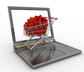 Supermarket trolley full of red hearts on laptop.