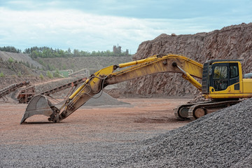 earth mover in a Porphyry rock quarry