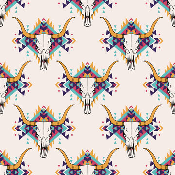Vector tribal seamless pattern with bull skull and decorative ethnic ornament. Boho style. American indian motifs.