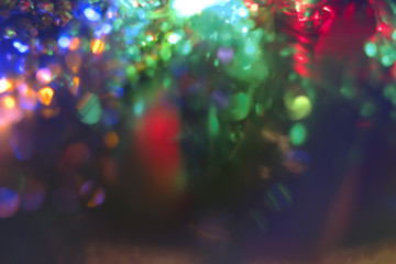 Holiday Background. Multicolor Holiday glowing Abstract Glitter Defocused Background With Place for Text. Blurred Bokeh, vintage color