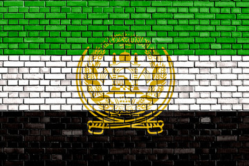 old flag of Afghanistan painted on brick wall