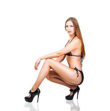 Beautiful slim bikini woman on high heels