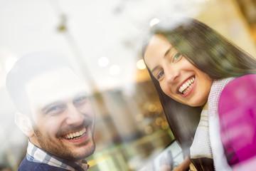 Couple having fun in cafe