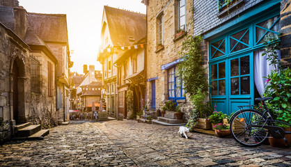 Old town in Europe at sunset with retro vintage Instagram style filter and lens flare effect Wall mural