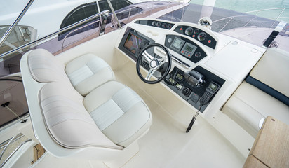 Interior of luxury yacht with driving place.