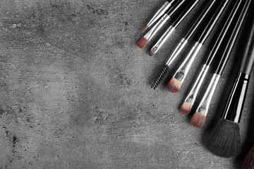 Makeup brushes on gray background