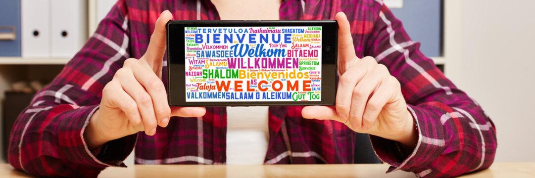 Willkommen in vielen Sprachen auf Smartphone