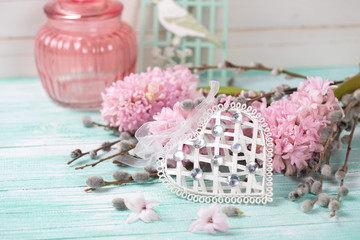 White decoratve heart with hyacinths and  willow branches  on tu
