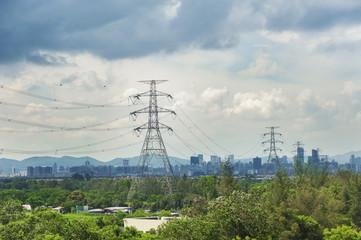 Electric Pylon with city skyline background