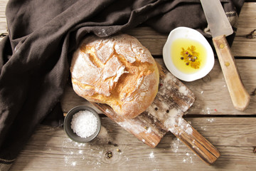 Fresh bread with salt and a delicious olive oil