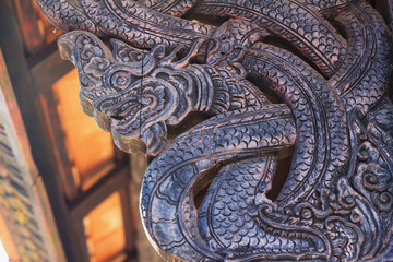 Wood carving in a thai temple.