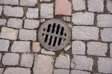 Manhole in paving stones