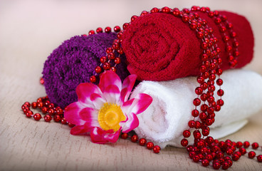 White and red towel around beads and flowers