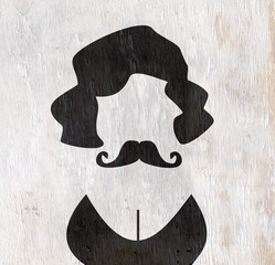 person with mustache and cleavage on wood grain texture