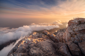 Photo sur Aluminium Lavende Beautiful landscape on the top of mountains with low clouds at sunset. Nature background