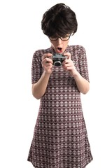 Surprised girl with pop look holding a camera