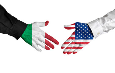 Italy and United States leaders shaking hands on a deal agreement