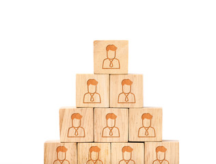 close up at People profile icon on wood cube arrange in pyramid