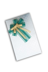 Beautiful silver gift box with green ribbon isolated on white ba