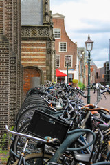 Parked bicycles on the street in the historic center of Haarlem,